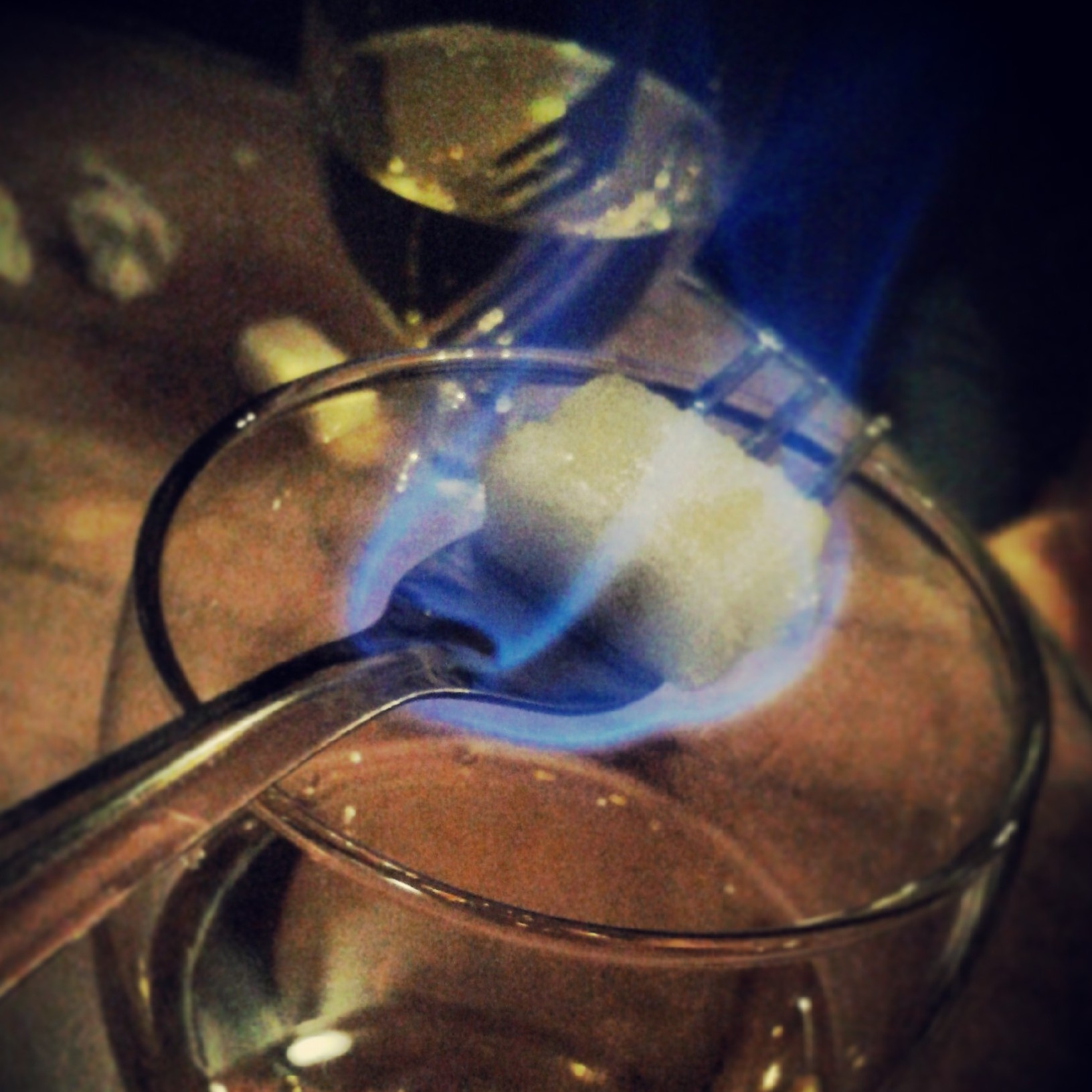 Blue flame over absinthe